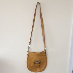 B Makowsky mustard shoulder or crossbody bag.